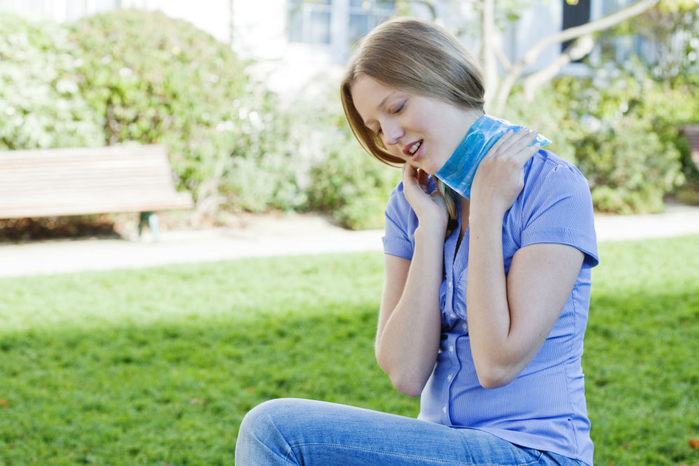 Woman with Heating Pads on neck
